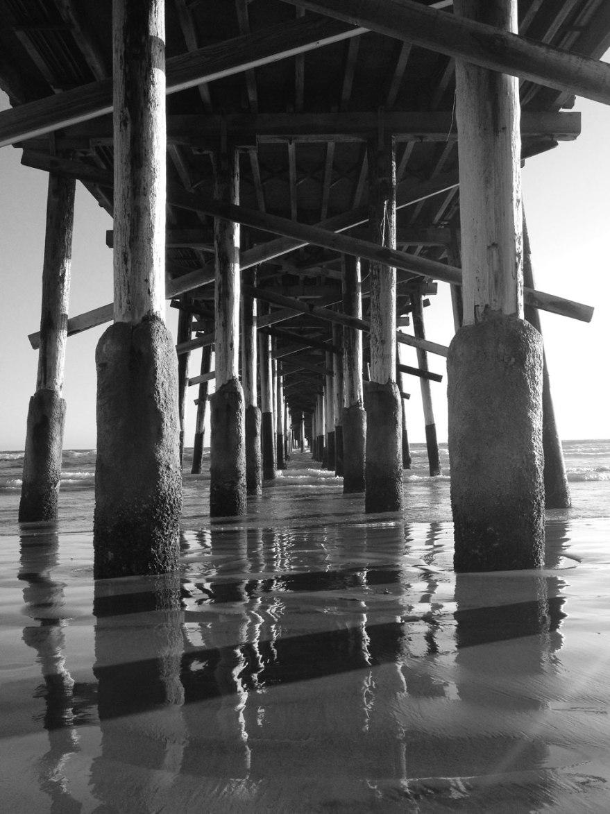 black and white pier boardwalk